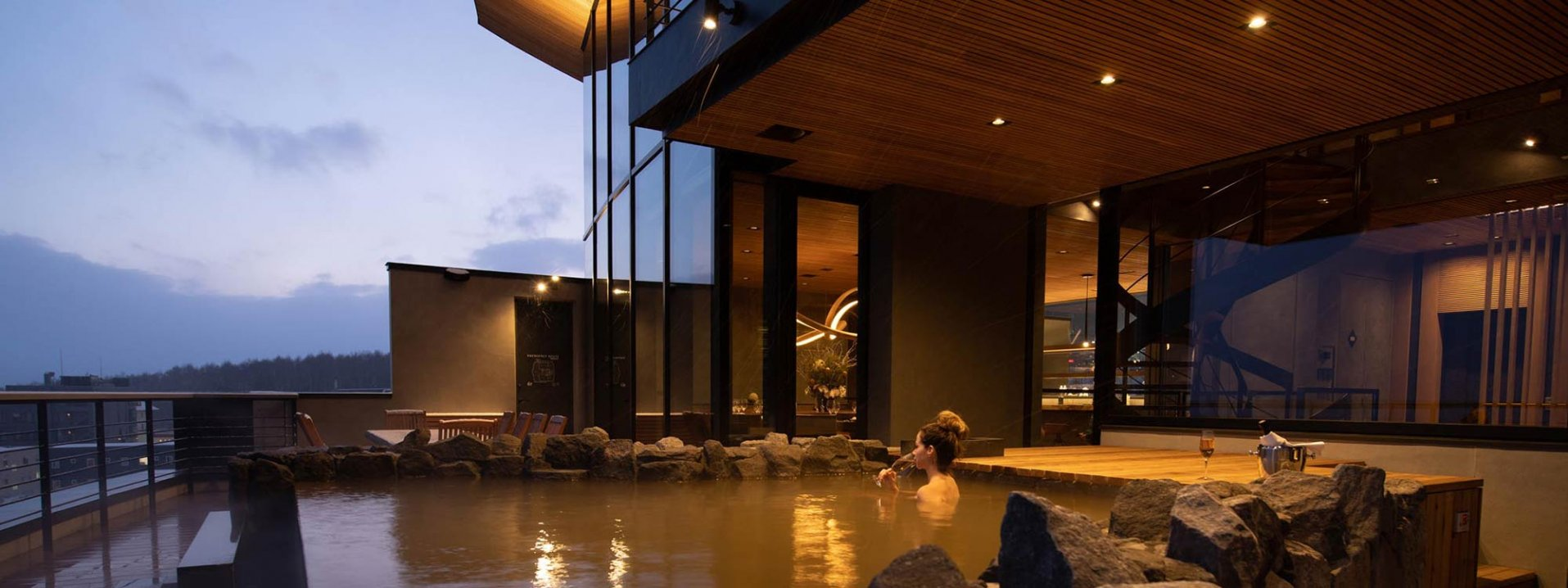 Luxury Snow Accommodation - Woman in penthouse spa